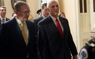 US Vice President Mike Pence and Mick Mulvaney (L), Director of the Office of Management and Budget (OMB) and incoming White House Chief of Staff, walk between meetings to discuss a possible government shutdown, at the US Capitol in Washington, DC, December 21, 2018. (SAUL LOEB / AFP)