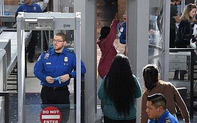Illustrative: Transportation Security Administration (TSA) officers work unpaid on the first day of the US government shutdown, at LAX Airport in Los Angeles, California, on December 22, 2018. (Mark RALSTON / AFP)