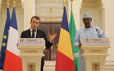 France's president Emmanuel Macron (L) and Chad's president Idriss Deby hold a press conference at the presidential palace in N'Djamena, on December 23, 2018. (Photo by Ludovic MARIN / AFP)