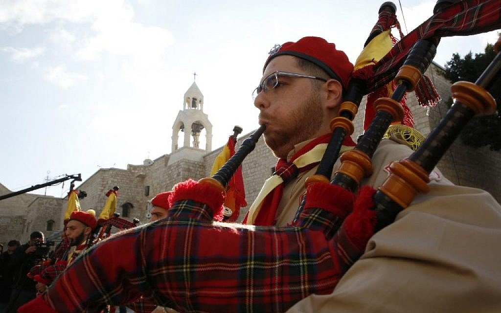 A Palestinian bagpiper blows his instrument as a band performs on Manger square in front of the Church of the Nativity in the biblical West Bank city of Bethlehem, on December 24, 2018. (HAZEM BADER/AFP)