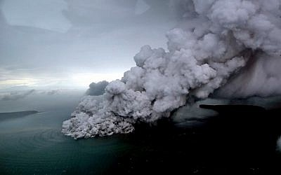 This aerial picture taken on December 23, 2018 by Bisnis Indonesia shows the Anak (Child) Krakatoa volcano erupting in the Sunda Straits off the coast of southern Sumatra and the western tip of Java. (Nurul HIDAYAT/AFP)