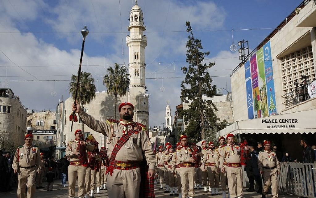 A Palestinian band performs on Manger square in front of the Church of the Nativity in the biblical West Bank city of Bethlehem, on December 24, 2018. (HAZEM BADER/AFP)