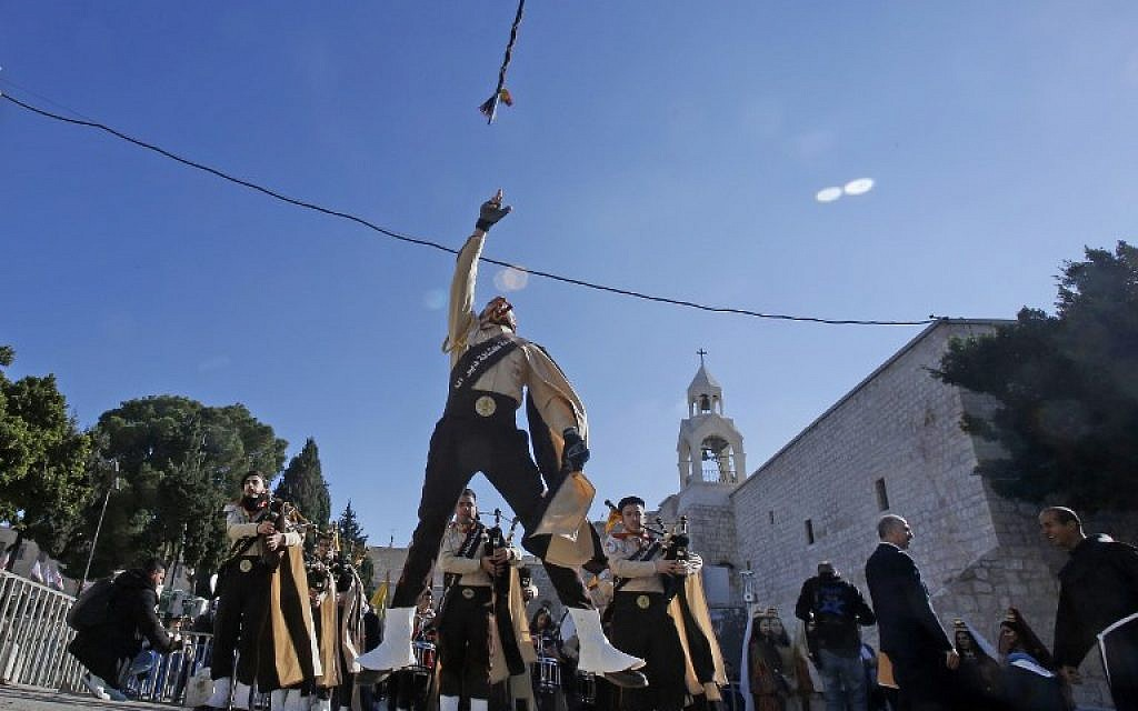 Thousands celebrate Christmas in Bethlehem with waning