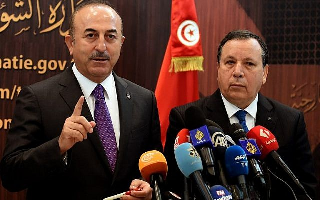 Turkish Foreign Minister Mevlut Cavusoglu,left, attends a press conference with Tunisian Foreign Affairs Minister Khemaies Jhinaoui, in Tunis, Tunisia, on December 24, 2018. (FETHI BELAID/AFP)