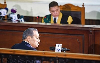Egyptian judge Mohammed Shirin Fahmi (background) listens to the testimony of former president Hosni Mubarak (front), who was ousted following a popular uprisal in 2011, during a session in the retrial of members of the now-banned Muslim Brotherhood on charges of plotting jailbreaks and attacks on police during the 2011 uprising, at a make-shift courthouse in southern Cairo on December 26, 2018. (Mohamed el-Shahed/AFP)