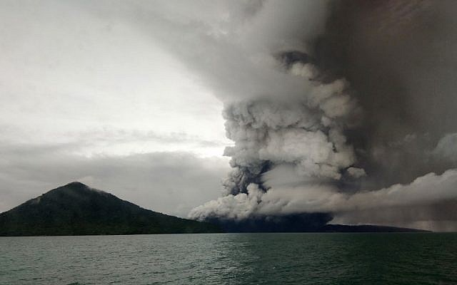 The Anak (Child) Krakatoa volcano erupting, as seen from a ship on the Sunda Straits, on December 26, 2018 (STR / AFP)