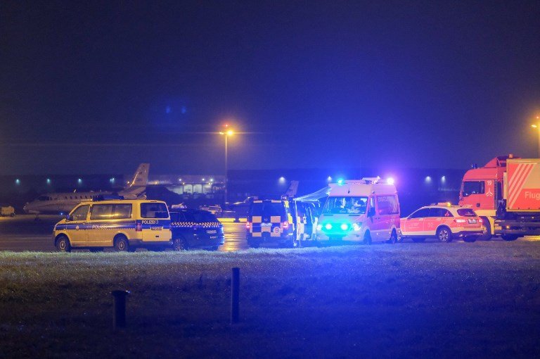 Flights suspended at German airport after car crashes onto runway