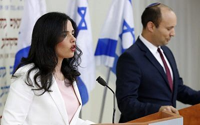 Justice Minister Ayelet Shaked, left, and Education Minister Nafatli Bennett announce the establishment of HaYamin HeHadash party at a press conference in Tel Aviv on December 29, 2018. (Jack Guez/AFP)