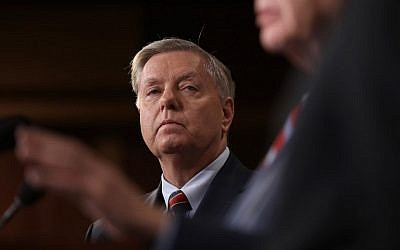 Senator Lindsey Graham (R-SC) listens during a press conference at the US Capitol in Washington, DC, on US President Donald Trump's decision to remove US military forces from Syria. December 19, 2018. (WIN MCNAMEE / GETTY IMAGES NORTH AMERICA / AFP)