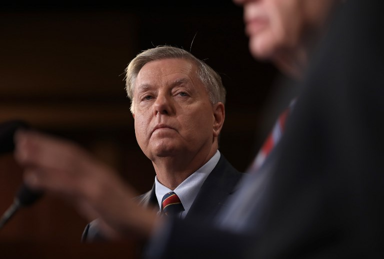 Senator Lindsey Graham listens during a press conference at the US Capitol in Washington DC on US President Donald Trump's decision to remove US military forces from