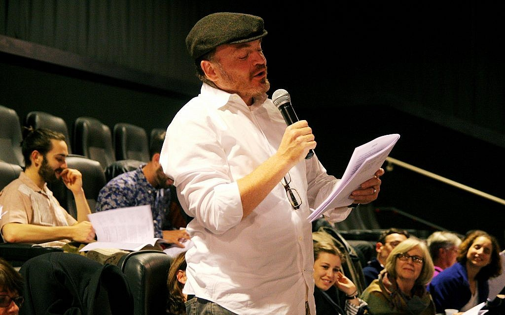 A participant joins in a 'Fiddler' reading at the Royal Theater in West Los Angeles, part of the Laemmle chain. (Courtesy of Laemmle.com/via JTA)