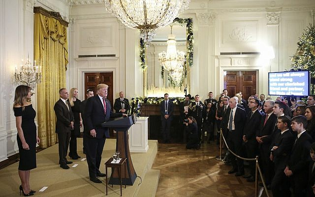 US President Donald Trump speaks at a Hanukkah reception in the East Room of the White House, December 6, 2018. (Oliver Contreras/Pool/Getty Images via JTA)
