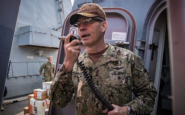 Vice Adm. Scott Stearney speaks on the shipboard intercom to welcome the crew of the guided-missile destroyer USS Jason Dunham to Manama, Bahrain, on October 24, 2018. (US Navy/ Jonathan Clay)