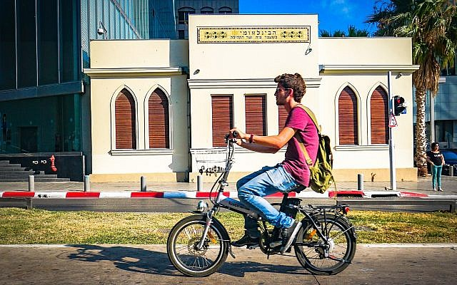 A man rides an electric bicycle in Tel Aviv on July 5, 2016. (Flickr/Ted Eytan/CC BY-SA)
