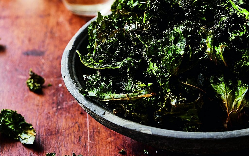 Crispy kale strips enhanced with poultry fat. (The Fat Kitchen © by Andrea Chesman. Photography/ © by Keller + Keller Photography/ Storey Publishing)