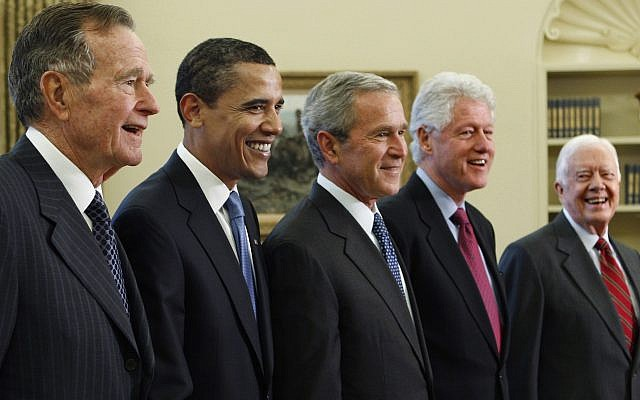 Then-US president George W. Bush, center, poses with then-president-elect Barack Obama, second left, and former presidents, George H.W. Bush, left, Bill Clinton, second right, and Jimmy Carter, right, in the Oval Office of the White House in Washington, January 7, 2009 (AP Photo/J. Scott Applewhite, File)