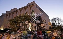 A menorah is tested outside the Tree of Life Synagogue in preparation for a celebration service at sundown on the first night of Hanukkah, Sunday, Dec. 2, 2018 in the Squirrel Hill neighborhood of Pittsburgh. A gunman shot and killed 11 people while they worshipped Saturday, Oct. 27, 2018 at the temple. (AP Photo/Gene J. Puskar)