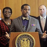 In this February 6, 2017, file photo, state Sen. Kevin Parker, a Democrat from Brooklyn, stands at the podium flanked by Senate members during a news conference at the Capitol in Albany, New York. (AP Photo/Hans Pennink, File)