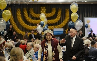 Two holocaust survivors arrive for Hanukkah candlelighting at the International Holocaust Survivors Night of the Jewish Community in Berlin, Germany, Tuesday, December 4, 2018. (AP Photo/Markus Schreiber)