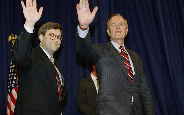 In this Nov. 26, 1991, file photo, President George H.W Bush, right, and William Barr wave after Barr was sworn in as the new Attorney General of the United States at a Justice Department ceremony in Washington. (AP/Scott Applewhite,File)