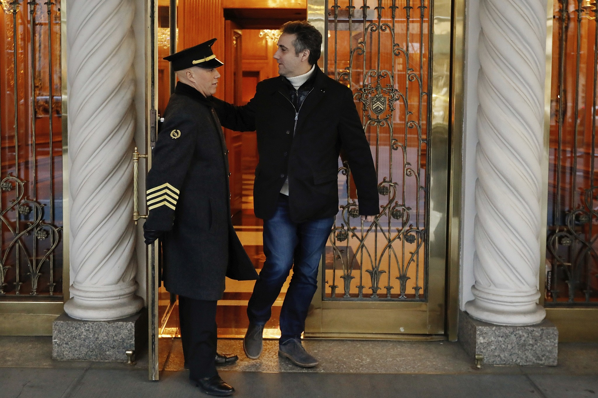 Michael Cohen former lawyer to President Donald Trump leaves his apartment building on New York's Park Avenue Friday Dec. 7 2018. In the latest filings Friday prosecutors will weigh in on whether Cohen deserves prison time and if so how much