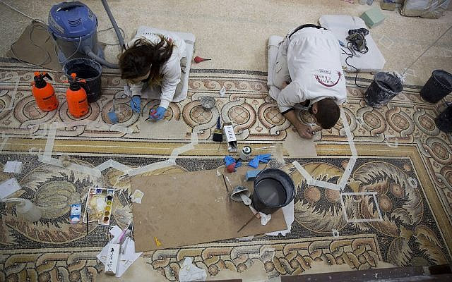 Restoration experts work on a mosaic inside the Church of the Nativity in the West Bank City of Bethlehem, December 6, 2018. (Majdi Mohammed/AP)