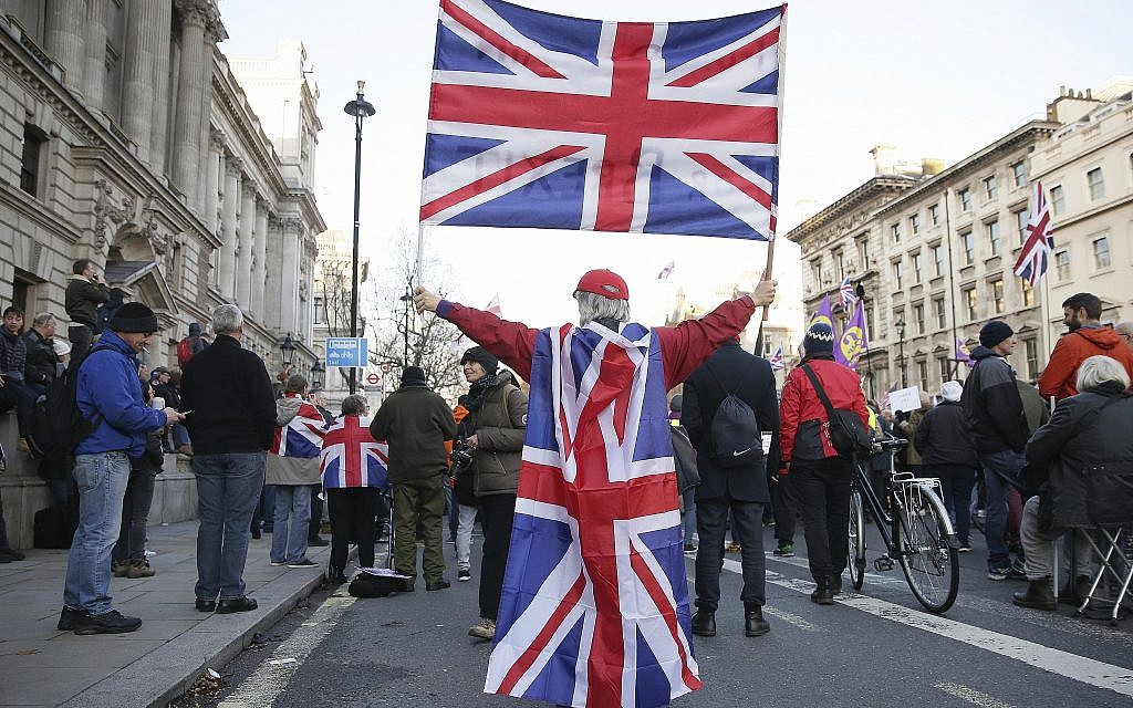 Demonstrators hold placards and flags at the 'Brexit Betrayal Rally,' a pro-Brexit rally, on Whitehall in London, December 9, 2018. (Tim Ireland/AP)