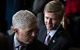 In a Monday, Dec. 3, 2018 file photo, Nick Ayers, right, listens as Supreme Court Associate Justice Neil Gorsuch waits for the arrival of the casket for former President George H.W. Bush to lie in State at the Capitol on Capitol Hill in Washington.(Jabin Botsford/The Washington Post via AP, Pool)