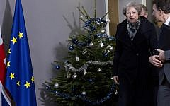 British Prime Minister Theresa May, center, walks past a holiday tree as she leaves the Europa building after a meeting with European Council President Donald Tusk in Brussels, December 11 2018. (Virginia Mayo/AP)