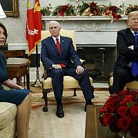 US President Donald Trump and Vice President Mike Pence, meet with House Minority Leader Nancy Pelosi, D-Calif., left, and Senate Minority Leader Chuck Schumer, D-N.Y., not shown, in the Oval Office of the White House, Tuesday, Dec. 11, 2018, in Washington. (AP Photo/Evan Vucci)