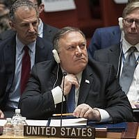 US Secretary of State Mike Pompeo adjusts his tie during a UN Security Council meeting on Iran's compliance with the 2015 nuclear agreement, on December 12, 2018, at United Nations headquarters. (AP Photo/Mary Altaffer)