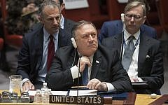 US Secretary of State Mike Pompeo adjusts his tie during a Security Council meeting on Iran's compliance with the 2015 nuclear agreement, on Dec. 12, 2018 at United Nations headquarters. (AP Photo/Mary Altaffer)