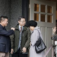 Huawei chief financial officer Meng Wanzhou, right, waves goodbye to visitors at her home in Vancouver on Wednesday, Dec. 12, 2018. The US has accused Huawei, the biggest global supplier of network gear for phone and internet companies, of using a shell company to do business with Iran in violation of US sanctions. (Jonathan Hayward/The Canadian Press via AP)
