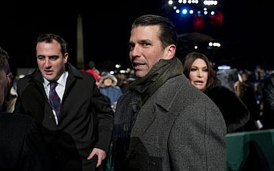 In this photo from November 28, 2018, Donald Trump Jr., center, and Kimberly Guilfoyle, right, depart following the National Christmas Tree lighting ceremony at the Ellipse near the White House in Washington. (AP Photo/Andrew Harnik, File)
