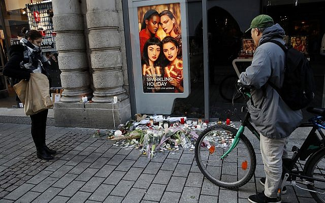 People pay respects at the site of a deadly terror attack in Strasbourg, eastern France, two days after the attack, on Thursday, December 13, 2018. (AP Photo/Christophe Ena)