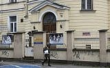 A person walks past the building where the 'Warsaw Ghetto Museum' will be located, in Warsaw, Poland, Friday, Dec. 14, 2018. (AP photo/Alik Keplicz)