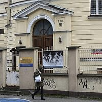 Illustrative: A person walks past the building where the 'Warsaw Ghetto Museum' will be located, in Warsaw, Poland, Friday, December 14, 2018. (AP photo/Alik Keplicz)