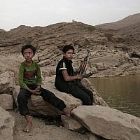 In this July 30, 2018, photo, a 17 year-old boy holds his weapon in High dam in Marib, Yemen (AP Photo/Nariman El-Mofty)