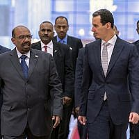 In this photo released by the Syrian official news agency SANA, Syrian President Bashar Assad, left, meets with Sudan's President Omar al-Bashir in Damascus, Syria, Sunday, Dec. 16, 2018 in Damascus. (SANA via AP)