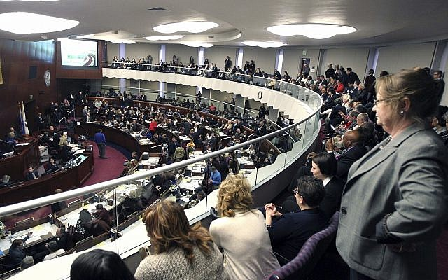 In this Feb 6, 2017, file photo, spectators look watch the Nevada State Assembly on the opening day of the Legislative Session in Carson City, Nev. Nevada became the first state in the U.S. with an overall female-majority in the Legislature on Tuesday, Dec. 18, 2018, when county officials in Las Vegas appointed two women to fill vacancies in the state Assembly. (AP Photo/Lance Iversen, File)