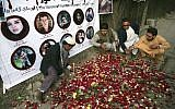 In this photo from May 3, 2018, Afghan residents light candles to pay tribute to Afghan journalists killed three days earlier in a suicide attack in Kabul, Afghanistan. (AP Photo/Rahmat Gul, File)