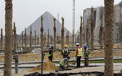 In this December 16, 2018 photo, workers landscape grounds at the Grand Egyptian Museum under construction in front of the Pyramids in Giza, Egypt. (AP Photo/Amr Nabil)