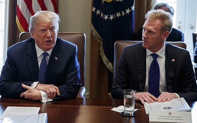 Then-deputy defense secretary Patrick Shanahan, right, listens as US President Donald Trump speaks during a Cabinet meeting at the White House, in Washington, DC, on April 9, 2018. (AP Photo/Evan Vucci, File)