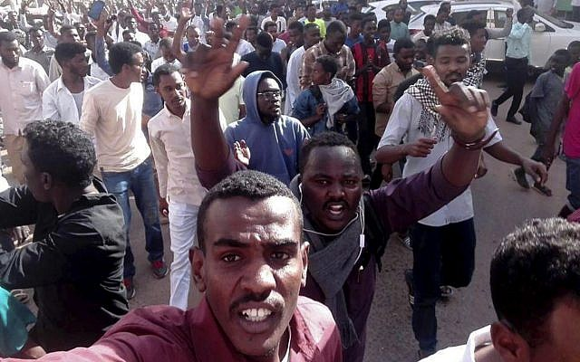 In this Thursday, December 20, 2018 handout photo provided by a Sudanese activist, protesters chant slogans during a demonstration in Khartoum, Sudan. (Sudanese Activist via AP)