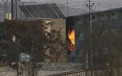 Flames rise from a government building after an explosion and attack by gunmen, in Kabul, Afghanistan, December 24, 2018. (AP Photo/Rahmat Gul)