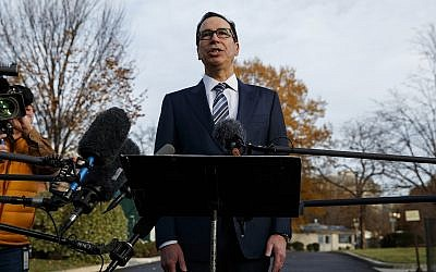 In this December 3, 2018, file photo, Treasury Secretary Steve Mnuchin talks with reporters at the White House in Washington. (AP Photo/Evan Vucci, File)