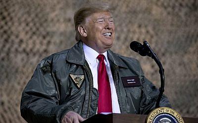 US President Donald Trump speaks at a hanger rally at Al Asad Air Base, Iraq, on December 26, 2018. (AP Photo/Andrew Harnik)