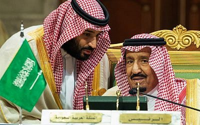 Saudi Crown Prince Mohammed bin Salman, left, speaks to his father, King Salman, at a meeting of the Gulf Cooperation Council in Riyadh, December 9, 2018. (Saudi Press Agency via AP)
