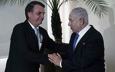 Brazil's President-elect Jair Bolsonaro, left, and Israel's Prime Minister Benjamin Netanyahu shake hands during a joint statement at the military base Fort Copacabana, in Rio de Janeiro, Brazil, Friday, Dec. 28, 2018. (Leo Correa/Pool Photo via AP)