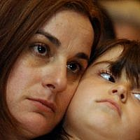 Rona Ramon, left, and her daughter Noa, in Cocoa Beach, Florida, on January 15, 2003, a day before the launch of the space shuttle Columbia. (AP Photo/Alan Diaz, File)